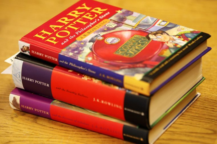 A first edition of 'Harry Potter and the Philosopher's Stone' by J K Rowling, top, a first edition of 'Harry Porter and the Deathly Hallows', middle, and a first edition of 'Harry Potter and the Prisoner of Azkaban' are seen on display before the start of 'Continental & English Antiquarian Books, Modern First Editions' auction in London, . The 'Harry Potter and the Philosopher's Stone' sold for a hammer down price of 12,000 pounds (US$17,567 or 13,978 euro), the 'Harry Porter and the Deathly Hallows' sold for 1,800 pounds (US$ 2,635 or 2,097 euro) and the 'Harry Potter and the Prisoner of Azkaban' for 220 pounds (US$322 or 256 euro