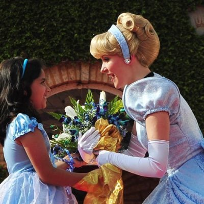 A Young Indian Girl Offers Flowers to Disney Fairy Tale Character Princess Cinderella During the Promotional Event in Southern Indian City of Bangalore 19 December 2011 Disney's Princess Cinderella and Her Prince Charming Are on Their First Visit to India This Christmas to Spread Good Cheer Cinderella Will Be Part of 20 Live Shows Across Five Cities Over 250 000 Disney Princess Fans Across Bangalore Delhi Hyderabad Chennai and Mumbai Will Get to See Her and the Prince in Person and Be a Part of the Celebration India Bangalore