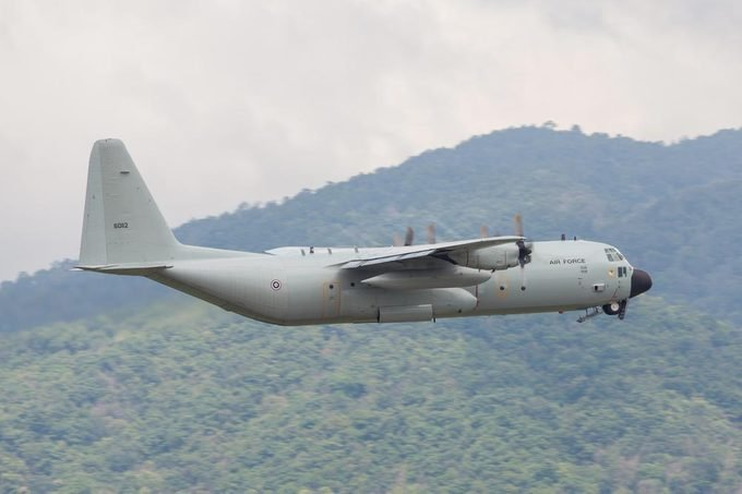 Chaing Mai Thailand 25 Aug 2016 : Royal Thai air force C-130 Was taking off from Chaing mai airport and gear up pass mountain.
