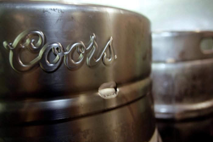 Barrels of Coors beer stand at Coors Field in Denver. Miller Coors' sustainability report, shows the brewer has cut down its water use to 3.48 barrels of water per barrel of beer a 9.2 percent drop from 2012. That's roughly 1 billion barrels of water