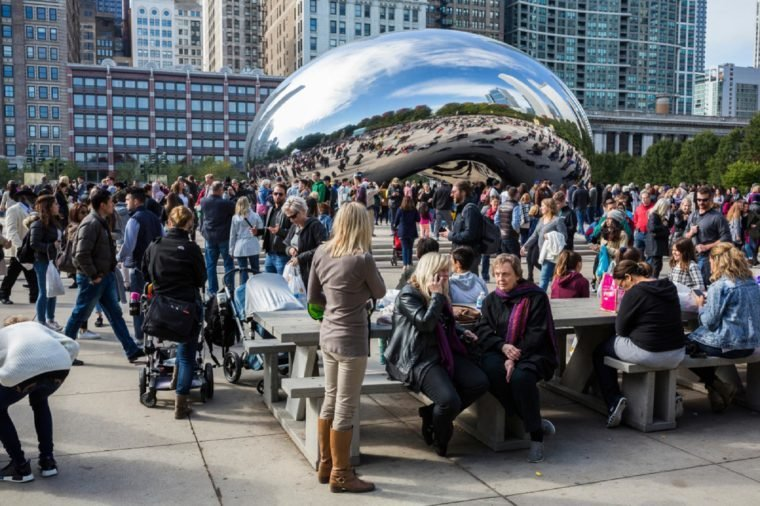Chicago, Illinois/USA-10/22/2016: Tourists seen in front of the Cloud Gate in Millenium Park in Chicago, Illinois.