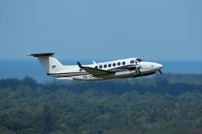 Phuket, Thailand. December 25, 2016. Siam Land Flying CO., Ltd Beechcraft King Air 350iER Reg. HS-CPA Taking Off from Phuket International Airport with Landscape and Seascape Background.