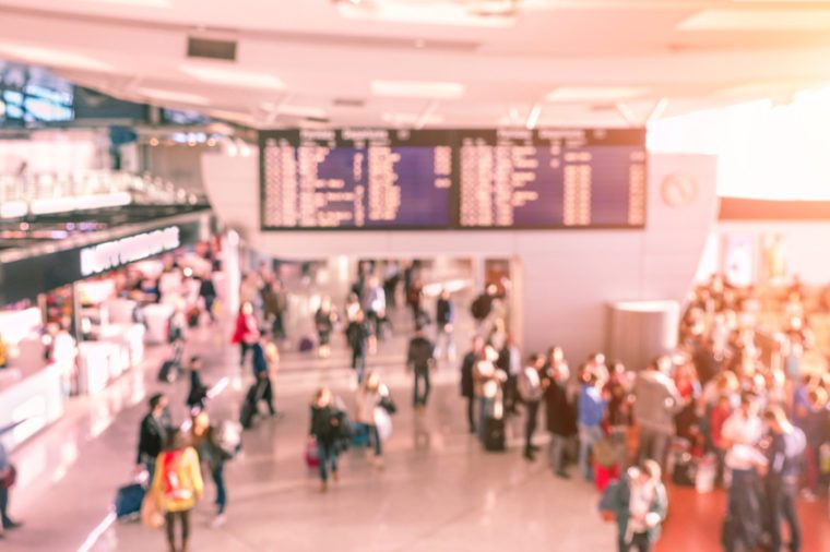 Blur background of people waiting indoor airport gates - Travel with flights concept - Defocused image - Soft rose quartz filtered look with artificial sunlight
