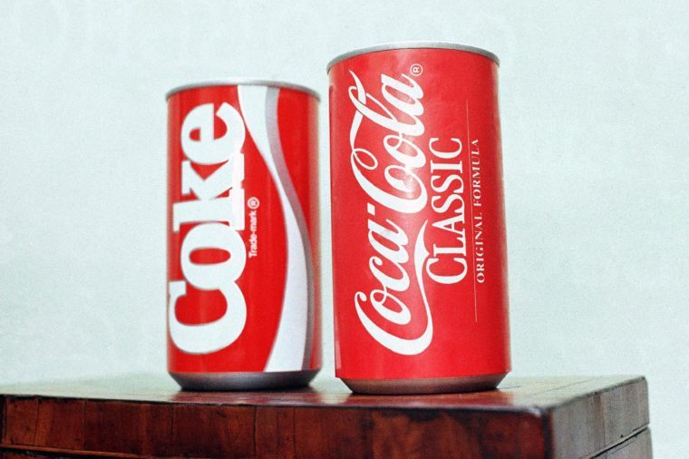 "Cans of New Coke and Coca-Cola Classic are on display during a news conference in Atlanta. New Coke's sweeter formula was a marketed as an improved replacement for the flagship soda, but the outcry was immediate and sustained. Coke tried to sell both versions for awhile, but eventually reverted to ""Coca-Cola Classic"