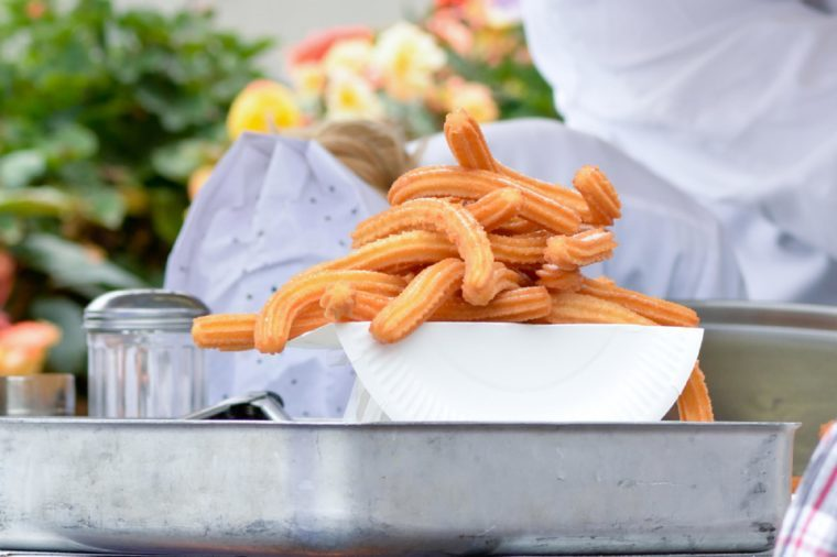 Churros on plate at food stall