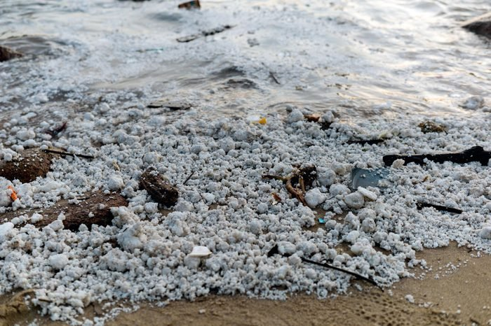 Clumps of palm oil dot the sand on Hung Shing Yeh Beach in Hong Kong, China, 06 August 2017. Nearly a dozen beaches across Hong Kong were closed to the public on 06 August, after congealed palm oil washed up on them. A Marine Department spokesman confirmed that two ships collided in the Pearl River estuary, in mainland Chinese waters, on 03 August and said that some of the vessel's cargo, palm oil, leaked into the sea. Palm oil is an edible vegetable oil from the fruit pulp of oil palm trees.