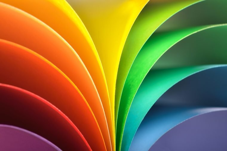 Abstract rainbow background with colored paper.Dark tones.