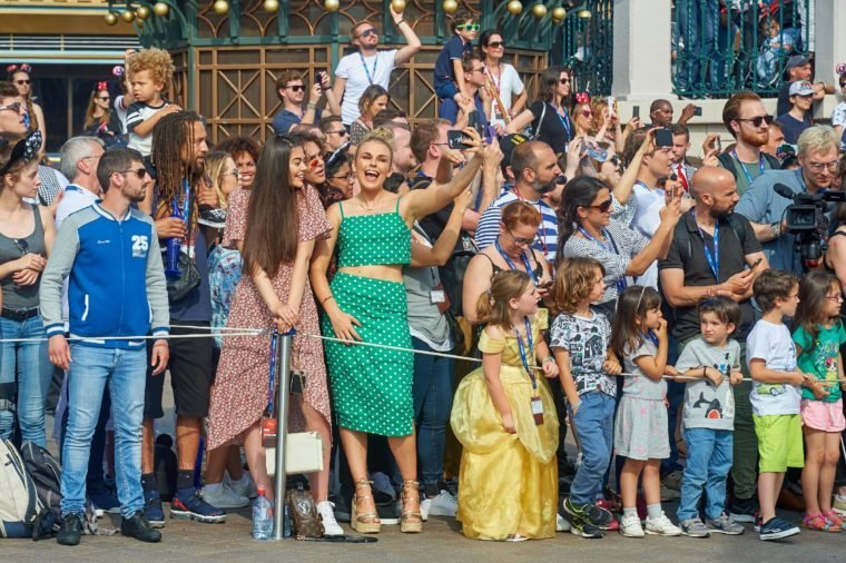 Tallia Storm and Emily Canham enjoy Disney Stars on Parade during the launch of Marvel Summer of Super Heroes at Disneyland Paris.