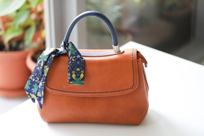 Dubai, UAE - May 20, 2018: Beautiful Susen women's handbag on table