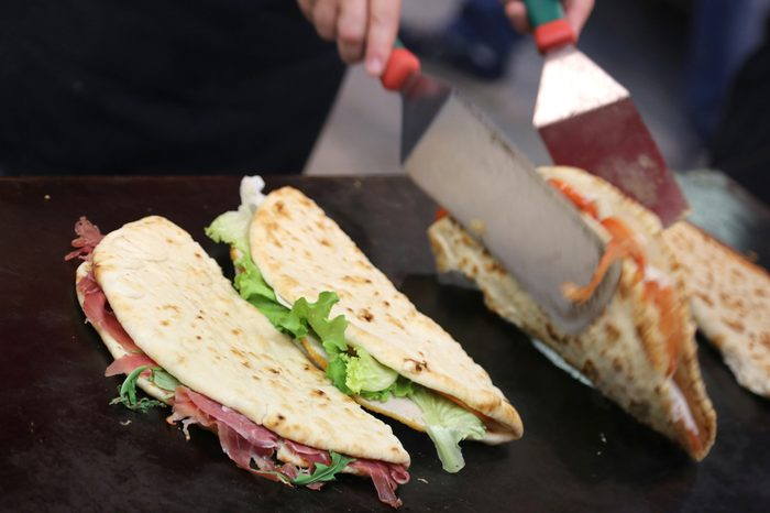 piadina in the roaring grill of the outdoor restaurant during the village festival