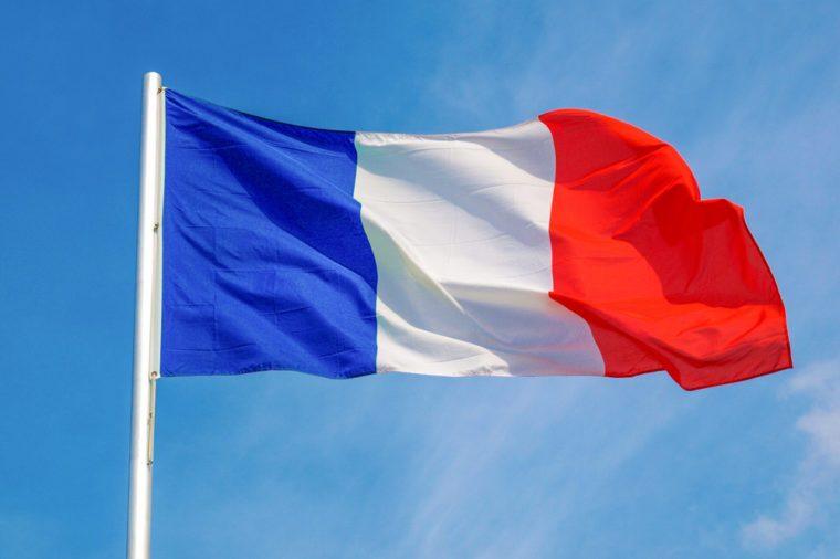 Flag of France over a blue sky