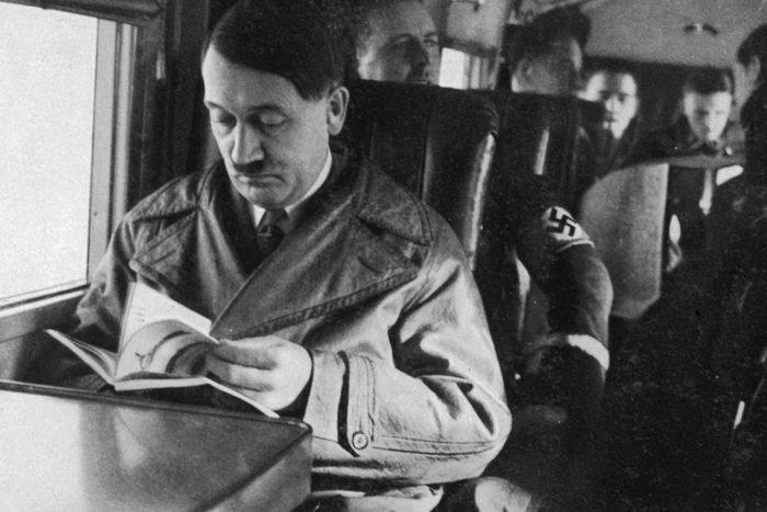 Adolf Hitler Reading On an Aeroplane Circa 1935