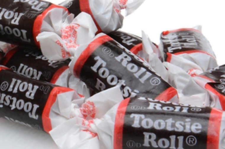 IRVINE, CALIFORNIA - DECEMBER 12, 2014: A box of Tootsie Roll 'Midgee' Candy. Tootsie Roll Industries is one of the largest candy manufacturers in the world, making than 64 million Tootsie Rolls daily