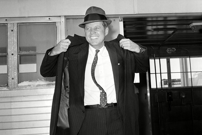 KENNEDY Sen. John F. Kennedy, D-Mass., is seen wearing a hat as he puts on his coat at Mitchell Airport before flying to Omaha from Milwaukee, Wis., . Kennedy formally announced today his intention to enter the April 5 Wisconsin presidential preference primary