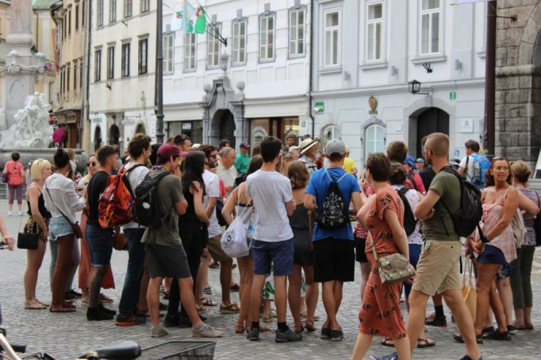 Ljubljana / Slovenia - 2017 : A crowd of tourists, standing and listening their guide during walking tour
