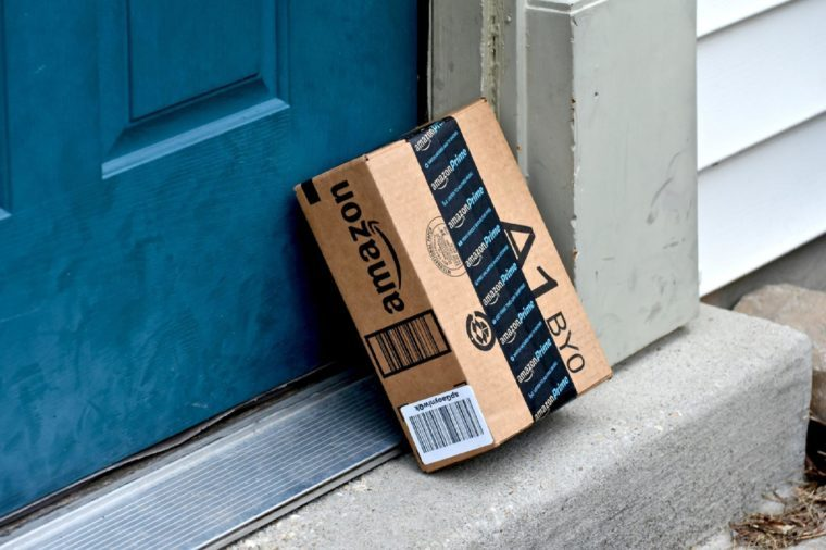 MARYLAND, USA - FEBRUARY 04, 2016: Image of Amazon packages delivered to a home. Amazon is the largest internet based retailer in the United States.