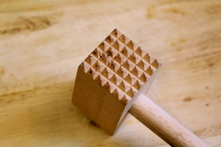 wood tenderizer on wood background