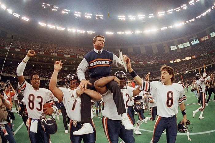 MIKE DITKA Chicago Bears coach Mike Ditka is carried off the field by Steve McMichael, left, and William Perry after the Bears defeated the New England Patriots 46-10 in NFL football's Super Bowl XX in New Orleans. Willie Gault (83) and Maury Buford (8) join the celebration