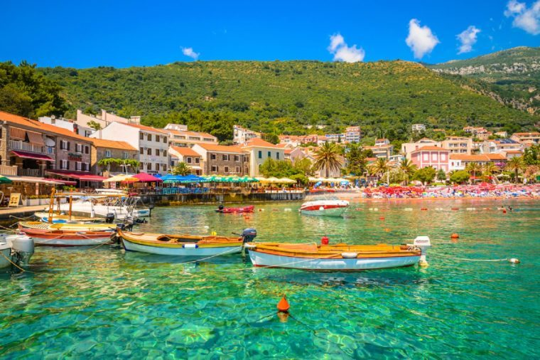 PETROVAC, MONTENEGRO, 01.07.2016: Beautiful mediterranean landscape - boats near town Petrovac, Montenegro.
