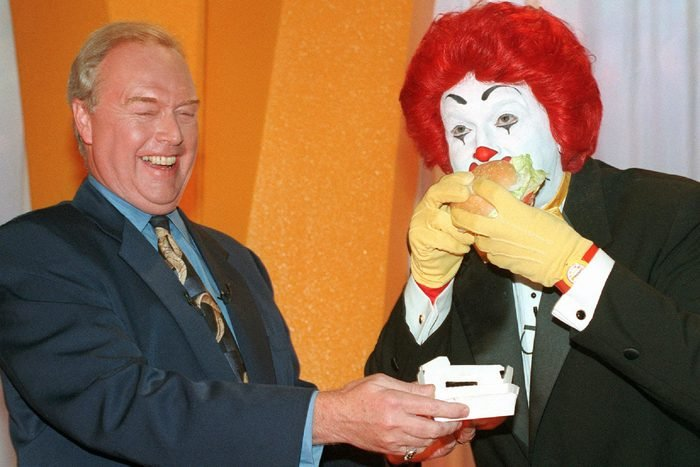 QUINLAN Michael R. Quinlan, chairman and chief executive officer of McDonald's Corporation, left, laughs as Ronald McDonald eats the new Arch Deluxe hamburger unveiled during a news conference at New York's Radio City Music Hall . The event, the largest new product launch in the company's history, is aimed at drawing more adults into the fast-food chain