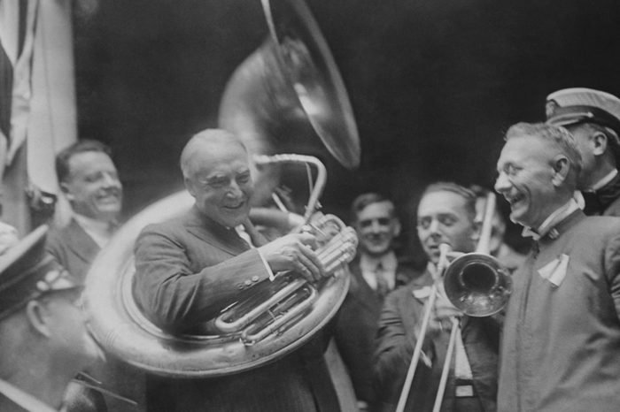 Republican Presidential nominee Warren Harding encircled by a sousaphone. August 1920. This created an amusing image for his 'front porch' campaign in 1920.