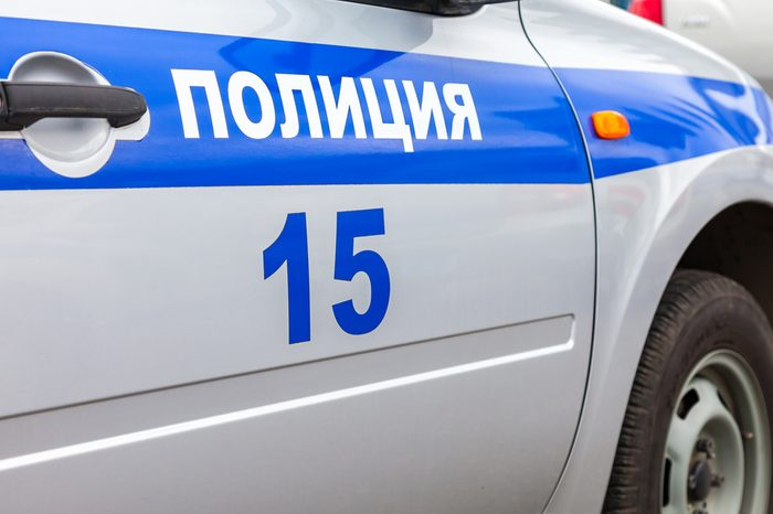 """Inscription """"Police"""" on the board of russian police car. Text in russian: """"Police"""""""