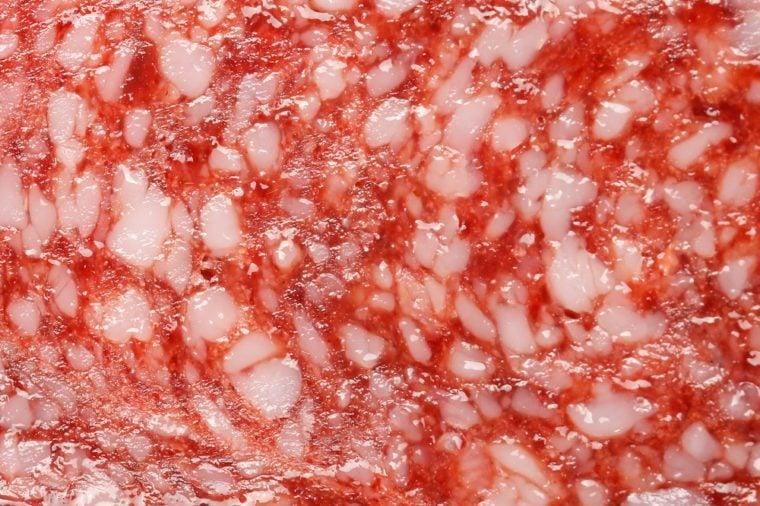 Sliced salami detail texture background