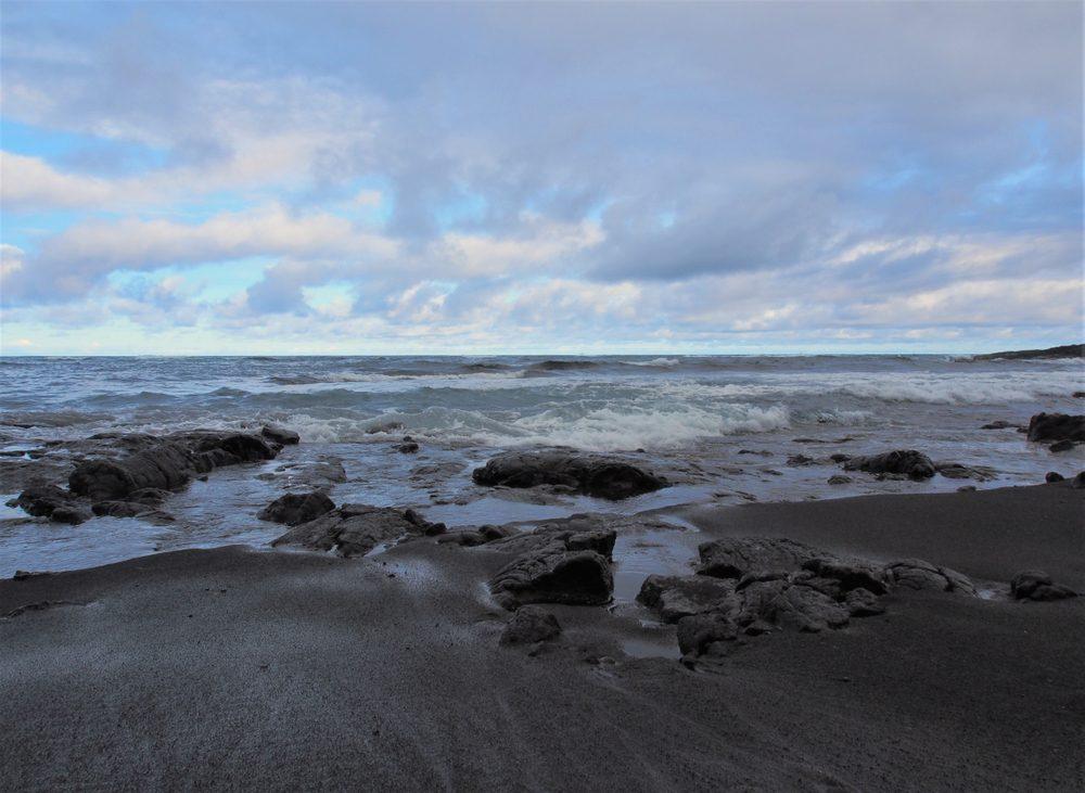 Punalu'u Black Sand Beach with Calm Waves, Rocks, and Cloudy Blue Sky, The Big Island, Hawaii