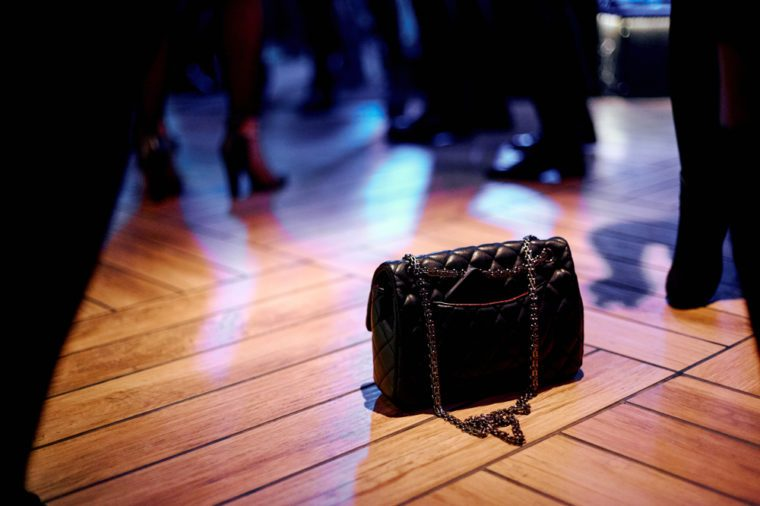 bag on the floor during a dancing in a nightclub