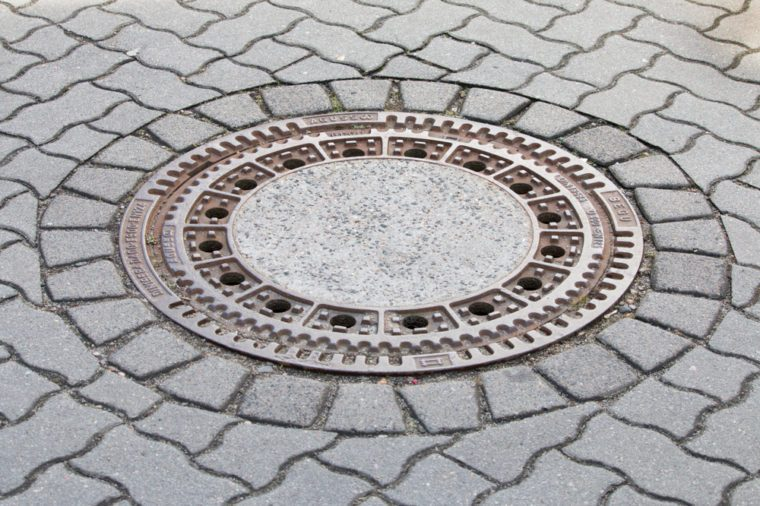 Cast iron manhole cover or gully cover on a street