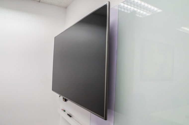 close up LED big Internet television screen with whiteboard in boardroom