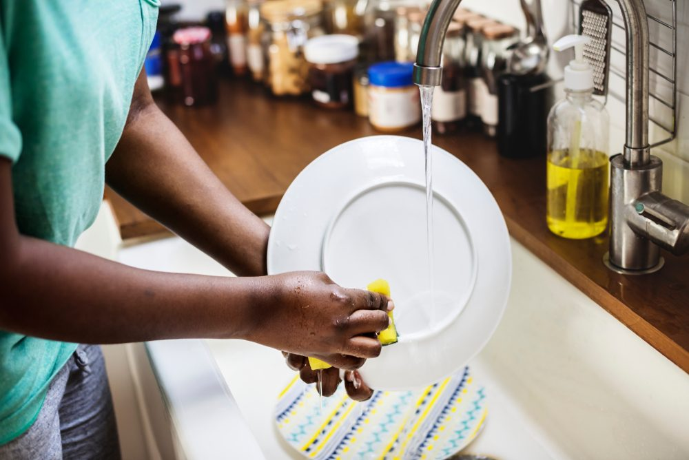 Black woman washing the dish