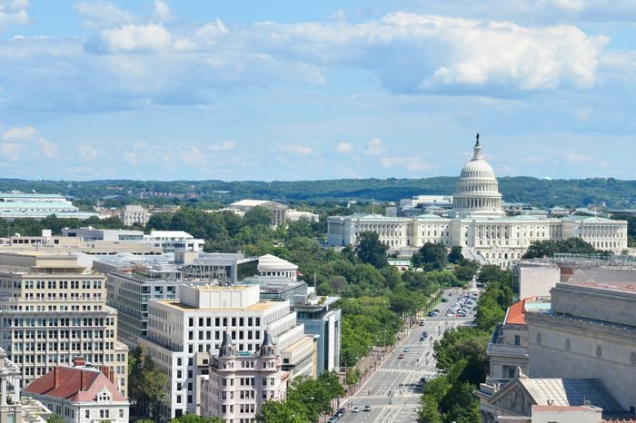 Washington D.C. - An aerial view of Pennsylvania Avenue with federal buildings including US Archives building, Department of Justice, FBI Headquarters and US Capitol Hill