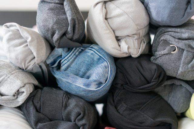 Fold cloth by rolling method.