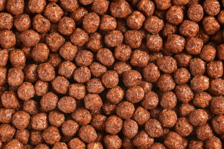 Chocolate breakfast cereal balls background or texture close up macro shot
