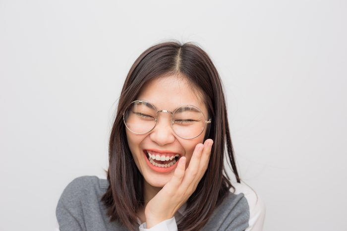 Laughing of asian beautiful positive thinking women with short hair on white background