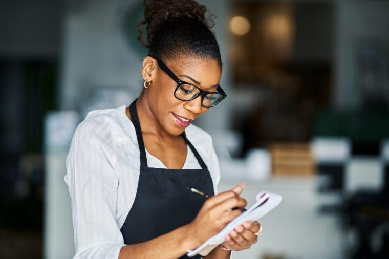 african american waitress taking order on notepad