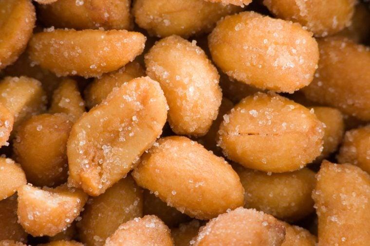 A pile of honey roasted peanuts macro shot.