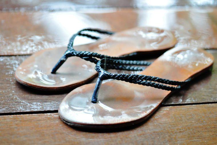 flip flops on wet wood planks