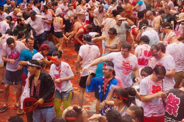 La Tomatina festival - tomatoes madness in August 28, 2013 in Bunol, Spain. Battle of tomatoes at street of city