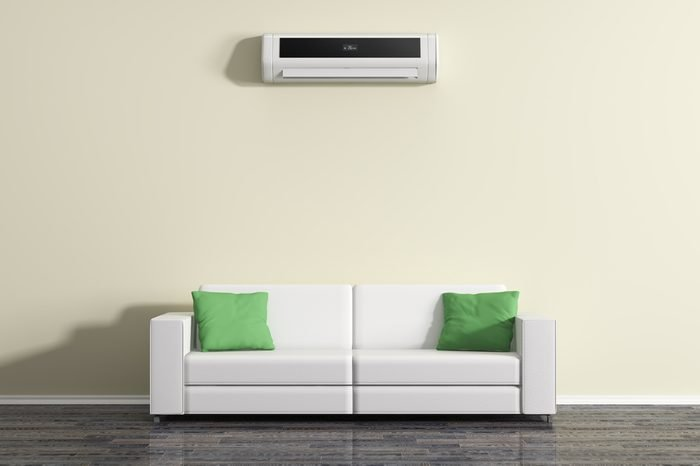 Air conditioning on the wall above the sofa.