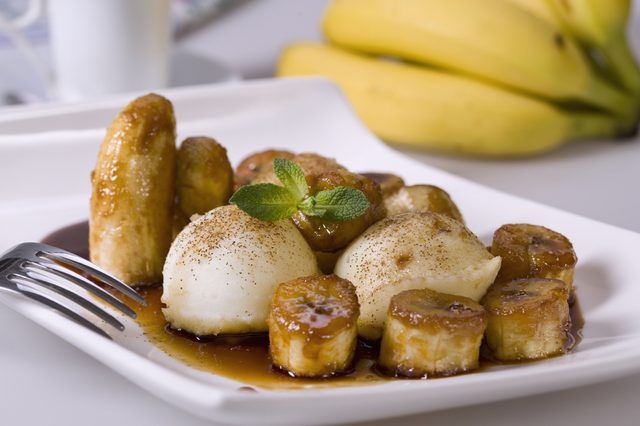Bananas Foster-style dish on white. Typical American food.