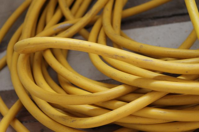 Yellow Power Extension Cord Wound Up