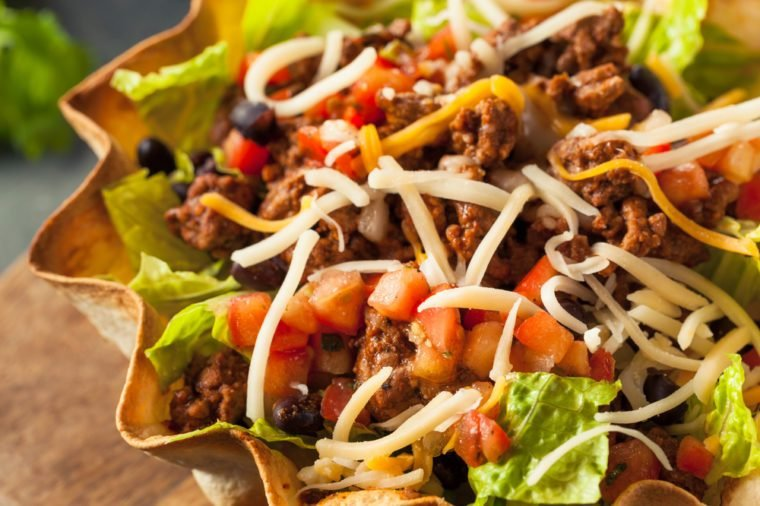 Taco Salad in a Tortilla Bowl with Beef Cheese and Lettuce