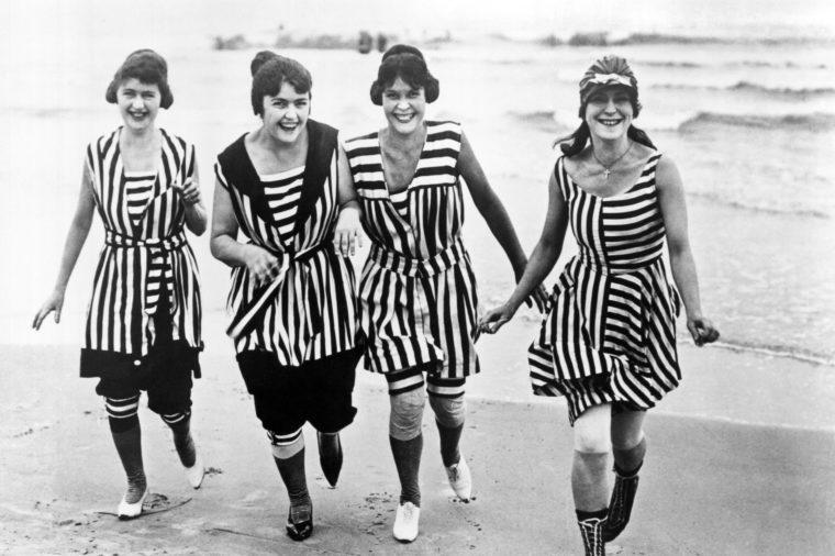 Four young women in matching beach wear
