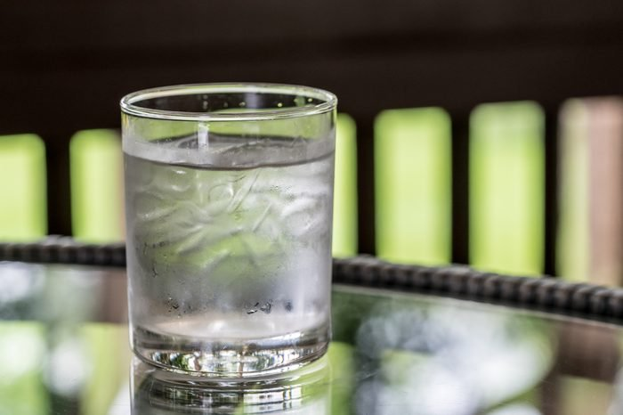 Glass of water on glass table