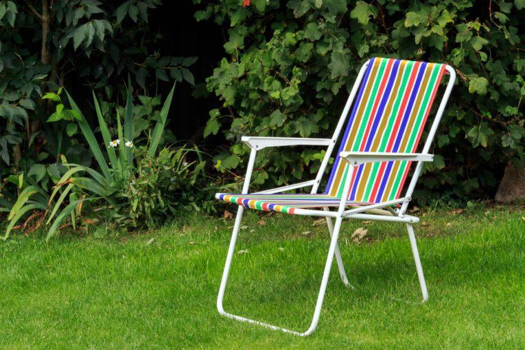 Rainbow colour striped Deck Chair on lawn