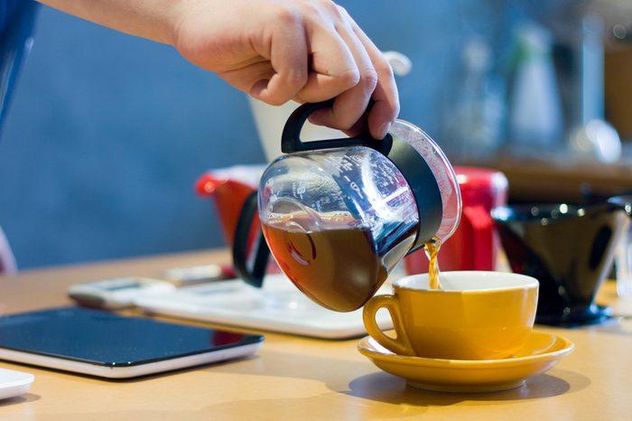 Barista serving gourmet coffee