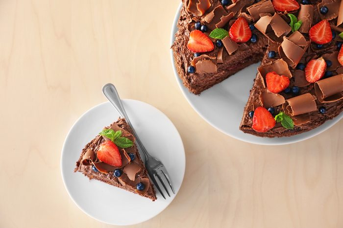 Delicious chocolate cake with strawberry on plate