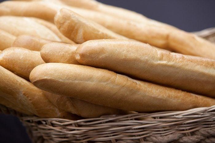 several baguettes wheat bread in wicker basket